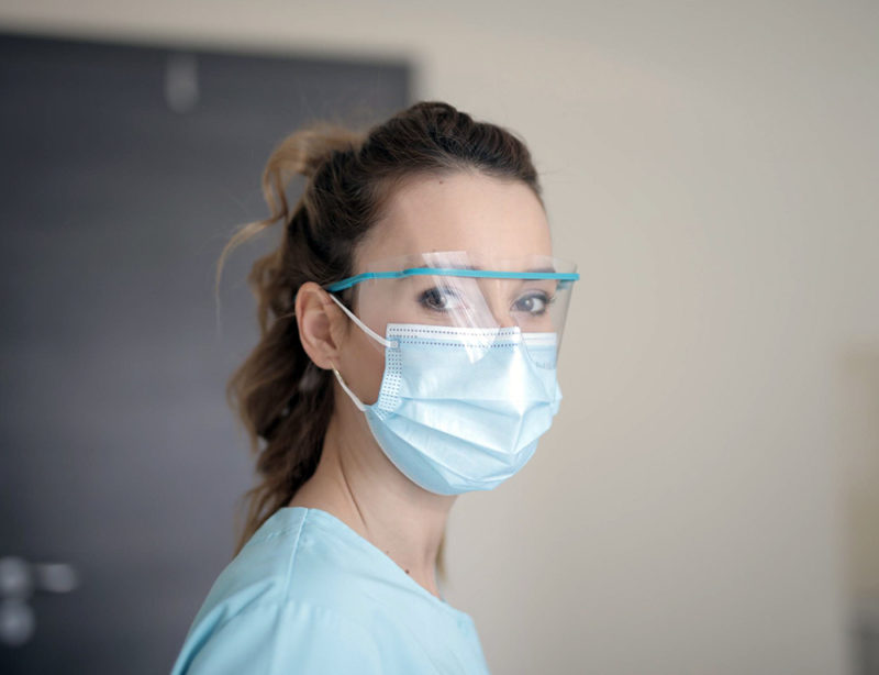 female medical professional wearing a disposable mask